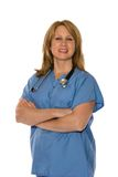 Medical Personnel Isolated On White. A female doctor or nurse in scrubs with a stethoscope around her neck isolated on white Royalty Free Stock Photography