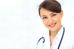Medical physician doctor. Woman over blue clinic background Royalty Free Stock Image
