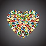 Medical pill forming Heart Stock Images