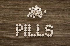 Medical pill on wooden table. Close up photo.  Stock Images