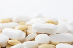 Medical pills. A lot of white and yellow medical pills Royalty Free Stock Image