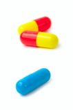 Medical pills. Three medical pills isolated on white background Stock Images