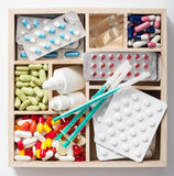 Medical pills and ampules in wooden box Royalty Free Stock Photography