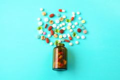 Medical pills and a bottle lie on the table. Medical concept Royalty Free Stock Images