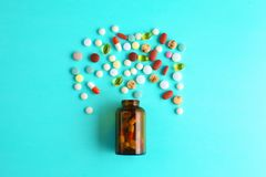 Medical pills and a bottle lie on the table. Medical concept Royalty Free Stock Photos