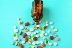 Medical pills and a bottle lie on the table. Medical concept Royalty Free Stock Photo