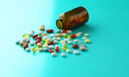 Medical pills and a bottle lie on the table. Medical concept Royalty Free Stock Image