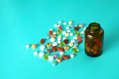Medical pills and a bottle lie on the table. Medical concept Stock Photo