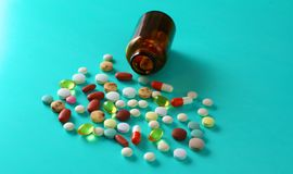 Medical pills and a bottle lie on the table. Medical concept Stock Image
