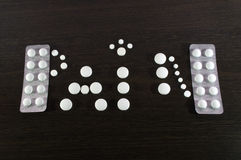Medical pills on dark background. Medical pills on dark wooden background Royalty Free Stock Photography
