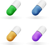 Medical pills in different colors. Colored medical pills on white background Stock Images