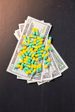 Medical pills or drugs and dollar cash money Stock Photos