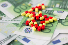 Medical pills or drugs and euro cash money Stock Image