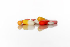 Medical pills and drugs lie in a pile Royalty Free Stock Photo