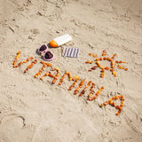 Medical pills, inscription vitamin A and accessories for sunbathing on sand at beach, healthy, beautiful and lasting tan Royalty Free Stock Images