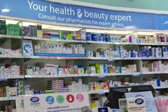 Medical pills and medical drugs on pharmacy stand in supermarket Siam Paragon. Bangkok, Thailand royalty free stock photo