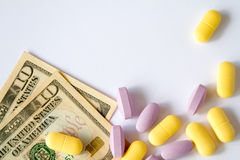 The medical pills are on a money Stock Image