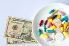 The medical pills are on a money Stock Photo