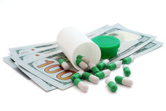Medical pills and money. Health care cost. Cost of Royalty Free Stock Photos