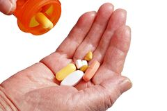 Medical pills in senior hand Stock Images