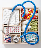 Medical pills stethoscope ampules in wooden box Stock Images