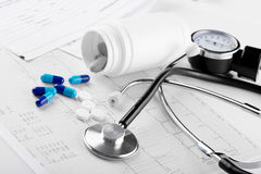 Medical pills and stethoscope. On the medical claim form Stock Photo