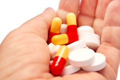 Medical pills and tablets. On the hand Stock Photo