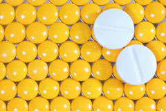 Medical pills on yellow pills background Stock Photography