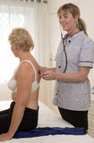 Medical practitioner examining a patient Royalty Free Stock Image