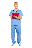 Medical practitioner posing with a clipboard Royalty Free Stock Photo