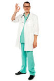 Medical practitioner showing excellent gesture Stock Photography