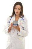 Medical Practitioner using a portable device with medical software.