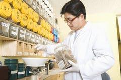 Medical Practitioner Weighing Ingredients Stock Image
