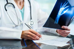 Medical practitioner writing down prescription. Stock Image