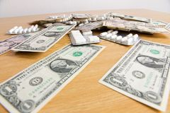 Medical preparations and dollars Royalty Free Stock Photos