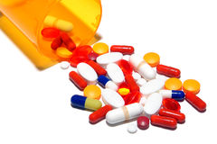 Medical Prescription Medicine Pills and Drug Abuse. Generic prescription medicine medication pills and OTC drugs spilled out of a pharmaceutical amber bottle as Stock Photos
