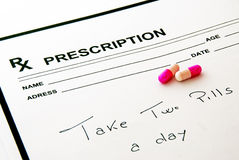 Medical prescription pad and pills Stock Images