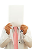 Medical presentation. Doctor holding a blank paper for your messages Royalty Free Stock Image