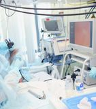 Medical procedure during video control in the ICU Stock Photos