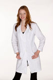 Medical Professional with Hands in Lab Coat Pockets. Young Female Medical Professional with Hands in Lab Coat Pockets Royalty Free Stock Images
