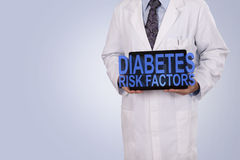 A medical professional holds a tablet displaying the words Diabe Royalty Free Stock Photos