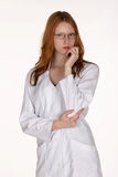 Medical Professional in Lab Coat with Hand on Chin Royalty Free Stock Photos