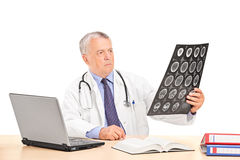 Medical professional looking at an x-ray Stock Photo