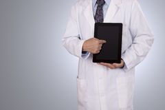 A medical professional pointing to his tablet computer. Royalty Free Stock Images