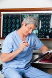 Medical Professional Reading Document Stock Image