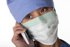 Medical Professional in Scrubs on the Phone Royalty Free Stock Photo