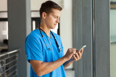 Medical professional smart phone. Modern medical professional using smart phone Royalty Free Stock Image