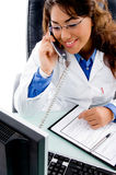 Medical professional talking on phone Stock Photography