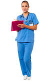 Medical professional writing case history Stock Photo