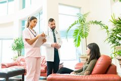 Free Medical Professionals Communicating With Woman At Hospital Stock Image - 166519001